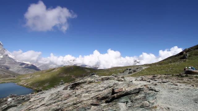 panning view of matterhorn glacier, switzerland - natural landmark video stock e b–roll