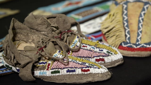 panning view of moccasins made by native americans - bead stock videos & royalty-free footage