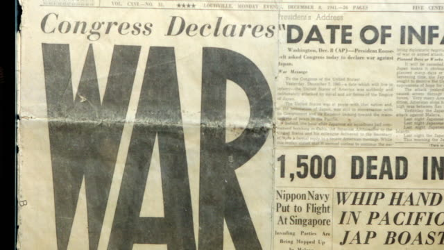 Panning view of newspaper talking about World War II