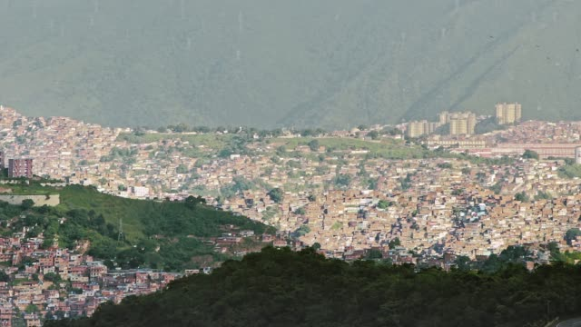 panning view of poverty and overpopulated areas in caracas, venezuela - caracas stock videos & royalty-free footage