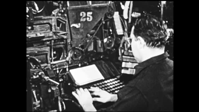 panning view of rows of workers working and typing in front of machines inside factory; close up of man typing - 1940 1949 video stock e b–roll