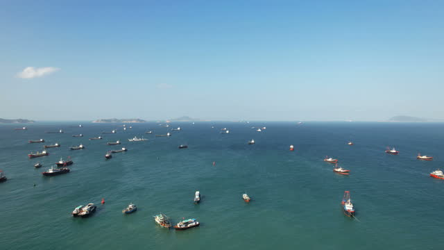 panning view of ships anchored in sea - anchored stock videos & royalty-free footage