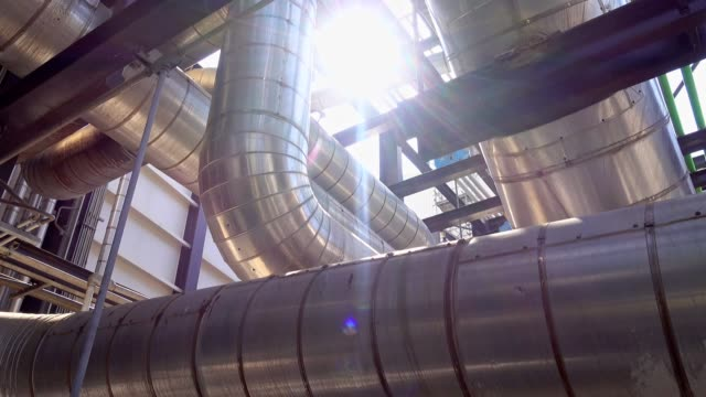 panning view of steam metal pipeline with insulation, labeled gags and valves in power plant - steam stock videos & royalty-free footage
