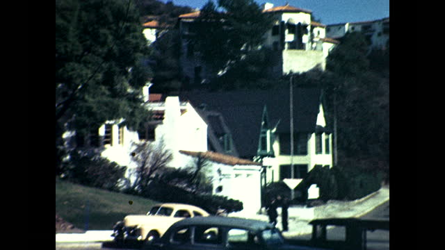 panning view of suburban neighborhood and the hills in the background; hollywoodland sign on the hill - suburban stock videos & royalty-free footage