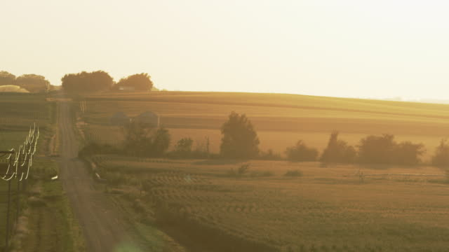 panning view of the valley farms. - nebraska stock-videos und b-roll-filmmaterial