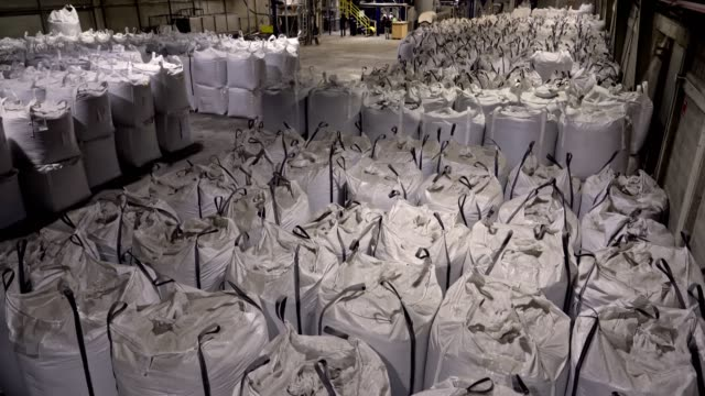 panning view of warehouse with sacks of pet crushed flakes for a recycling  plastic industry - sack stock videos & royalty-free footage
