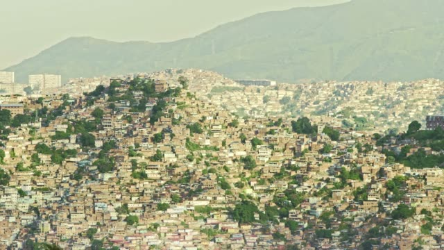 panning view of western district in caracas city valley with poverty zones - caracas stock videos & royalty-free footage