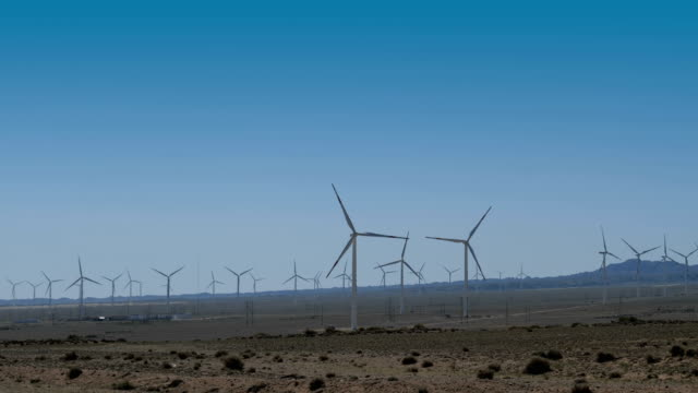 panning view of wind turbines in wilderness area - wilderness area stock videos & royalty-free footage