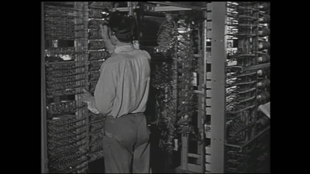 panning view of workers with headlights working on walls of circuits - 1940 1949 bildbanksvideor och videomaterial från bakom kulisserna