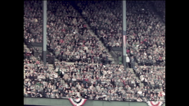 panning view of world series game at cleveland municipal stadium #27 of the indians hitting at home base #9 for milwaukee braves walking on the field... - milwaukee braves stock videos & royalty-free footage