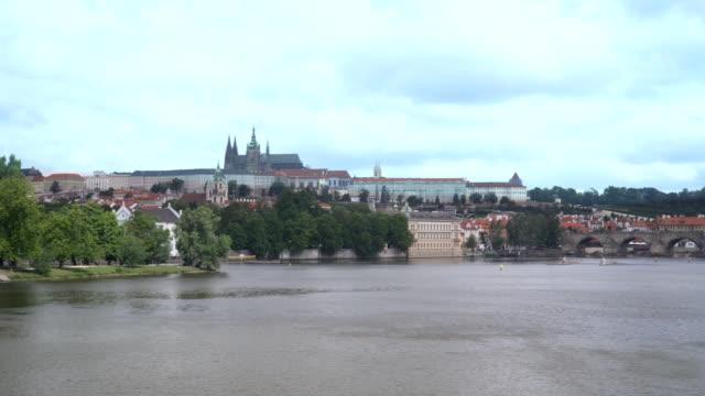 panning view on charles bridge at prague at night from vltava river, czech republic - vltava river stock videos & royalty-free footage