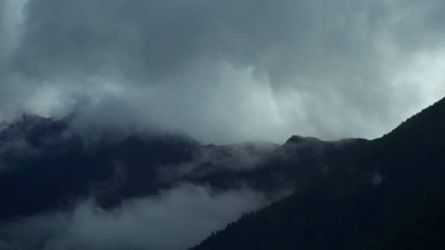 panning view: one peak of mount siguniang from entrance in changping gou valley or changping valley, rilong town, china under cloudy storm - mountain range stock videos & royalty-free footage