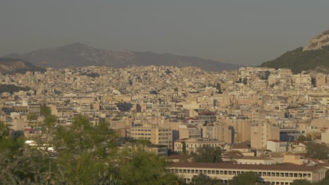 panning view to mount lycabettus from athens national observatory at sunset, athens, greece, europe - lycabettus hill stock videos & royalty-free footage