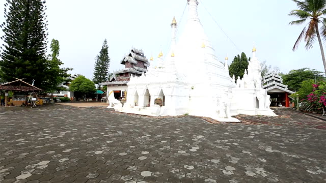 HD Panning: White pagoda in temple.