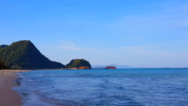 panning white sand beach and blue sea water - krabi province stock videos & royalty-free footage