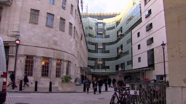 panning wide shot of bbc broadcasting house - pedestrian stock videos & royalty-free footage