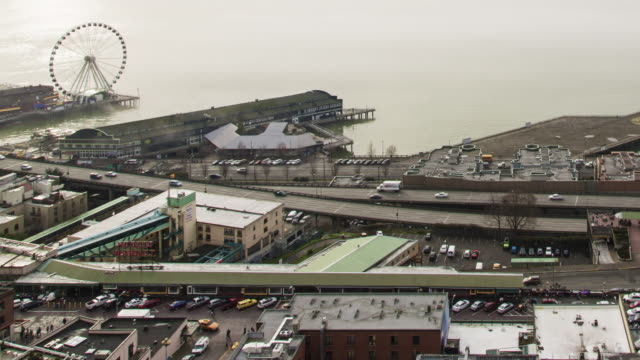 a panning, winter daytime time lapse of wispy fog moving over the seattle waterfront with pike place market in the foreground - pike place market stock videos and b-roll footage
