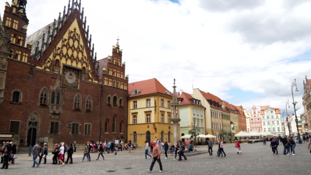 panning: wrocław town hall at market square in summer weekend, wroclaw, poland - european culture stock videos & royalty-free footage