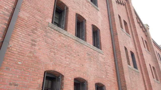 panning yokohama red brick warehouse in yokohama , japan . - brick stock videos & royalty-free footage