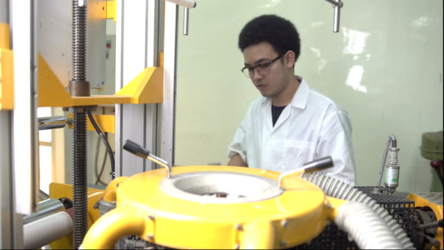panning: young scientist clear die of blown film extruder - polypropylene stock videos and b-roll footage