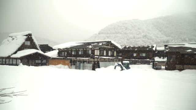 panning:snowing at japanese houses at Shirakawago village