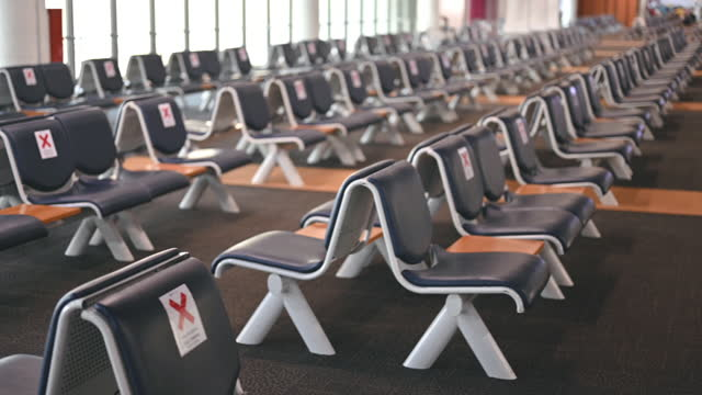 pannning wide angle emptry chair no people in re open airport after lockdown - crisis stock videos & royalty-free footage