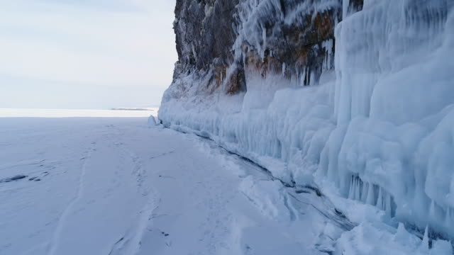 panorama along the icy rock of lake baikal - icicle stock videos and b-roll footage