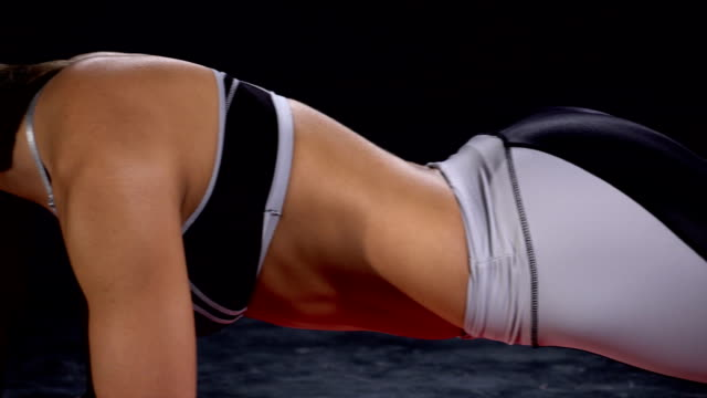 Panorama of a beautiful fit girl in plank position