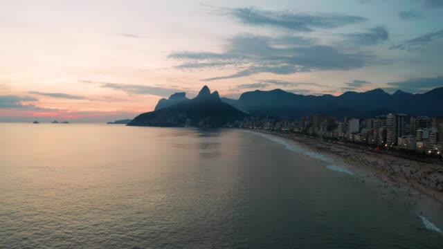 panorama of rio de janeiro at twilight, brazil. ipanema beach at sunset. rio de janeiro - dusk stock videos & royalty-free footage