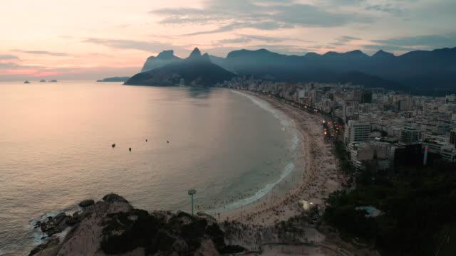 panorama of rio de janeiro at twilight, brazil. ipanema beach at sunset. rio de janeiro - rio de janeiro stock videos & royalty-free footage