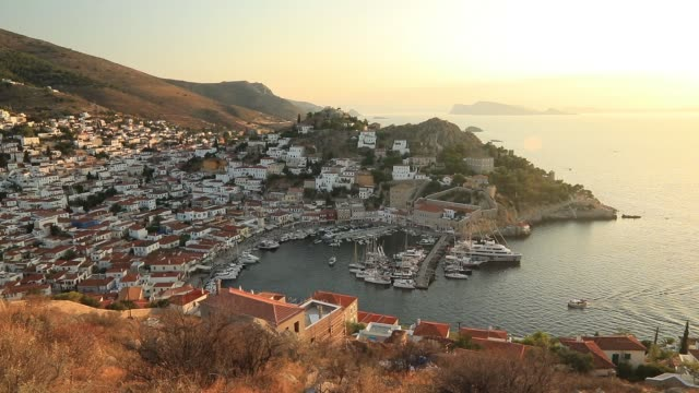 panorama of the beautiful sunset of hydra island, greece - griechenland stock-videos und b-roll-filmmaterial