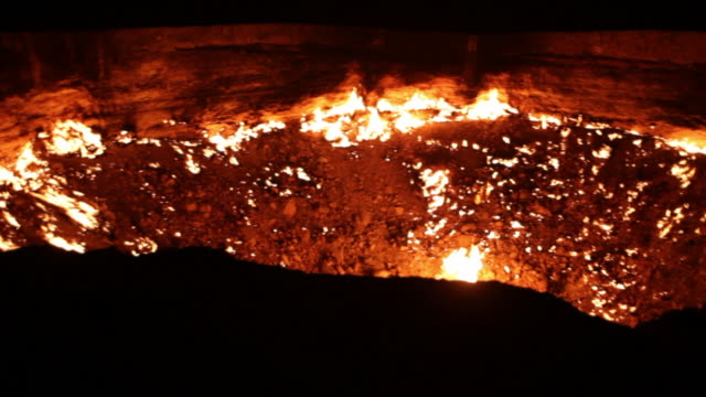 "panorama of the gas site burning at the ""door to hell"" or darvaza crater in turkmenistan at night - volcanic crater stock videos & royalty-free footage"