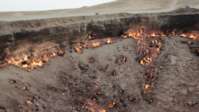 """Panorama of the gas site burning at The """"Door to Hell"""" or Darvaza Crater in Turkmenistan at dusk"""