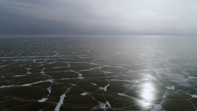 panorama view from the height of the frozen lake baikal - frozen stock videos & royalty-free footage