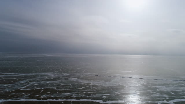 panorama view from the height of the frozen lake baikal - eingefroren stock-videos und b-roll-filmmaterial