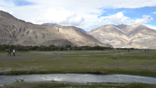 panorama view of nubra valley and a small lake in ladakh, india - mountain range stock videos & royalty-free footage