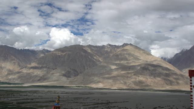 Panorama View of Nubra Valley and the giant Buddha statue at Diskit Monastery, Ladakh, India