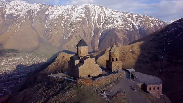 Panoramic Aerial 4K /Gergeti Trinity Church, Kazbegi mountain, Georgia