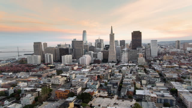 panoramic aerial sunset view of san francisco new emerging downtown skyline. - san francisco california video stock e b–roll