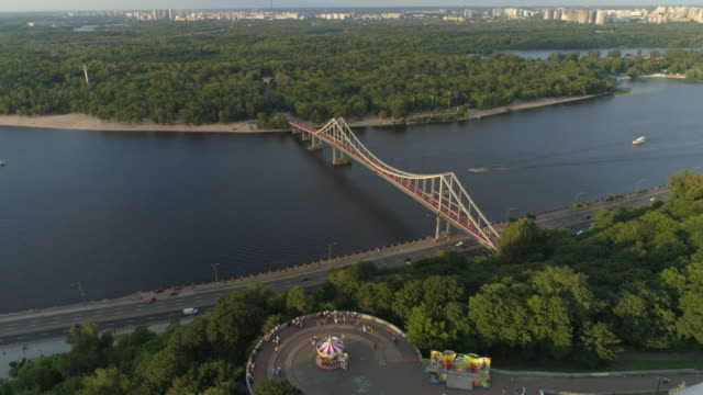 panoramic aerial view of city on the river - キエフ市点の映像素材/bロール