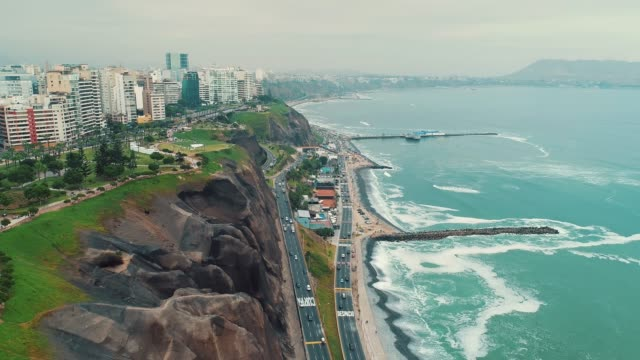panoramic aerial view of miraflores district coastline in lima, peru. - coastline stock videos & royalty-free footage