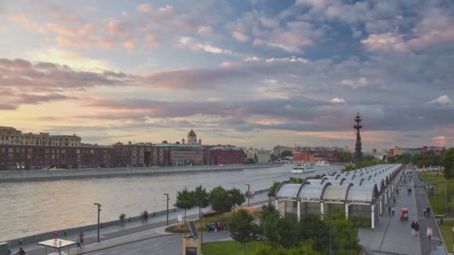 panoramic cityscape of moscow at sunset. public space in krymskaya embankment of moskva river at foreground and cathedral of christ the saviour at background. - moscow russia stock videos & royalty-free footage
