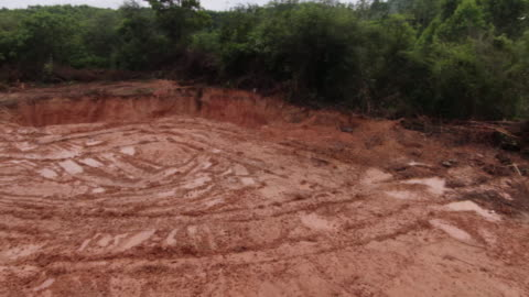 panoramic drone shot of a pit where pigs infected with african swine fever are buried in longtan town, bobai county, guangxi province, china. - healthcare and medicine or illness or food and drink or fitness or exercise or wellbeing stock videos & royalty-free footage