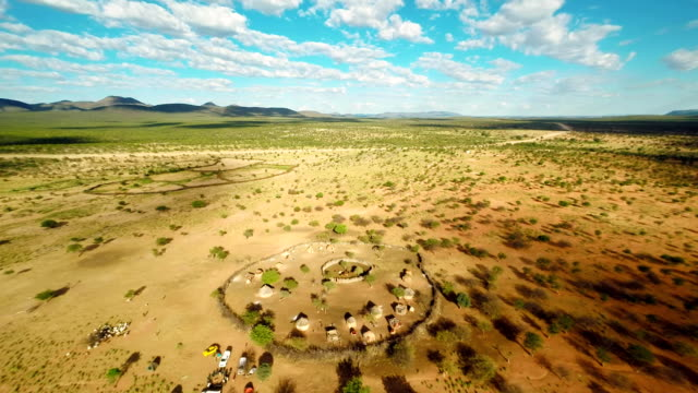 heli panoramic namibian landscape with the himba village - village stock videos & royalty-free footage