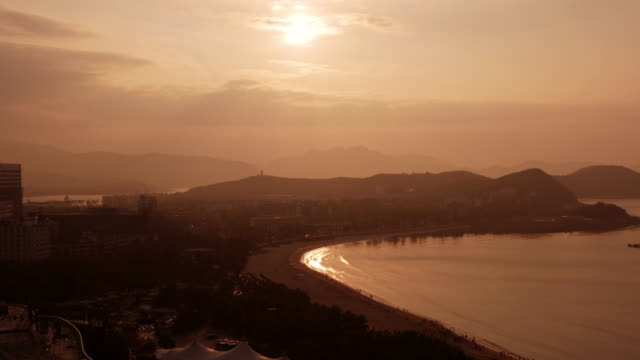 panoramic night to day time lapse of sanya bay, hainan province, china. - spoonfilm stock-videos und b-roll-filmmaterial