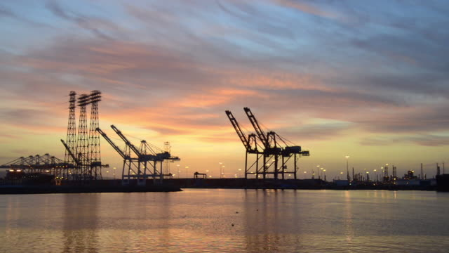 panoramic of the port of los angeles seen from a boat at dusk - port of los angeles stock videos & royalty-free footage