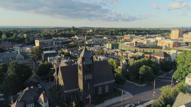 panoramic scenic view of bethlehem, pennsylvania, at sunset. fritz memorial united methodist church. aerial drone video. - bethlehem pennsylvania stock videos & royalty-free footage