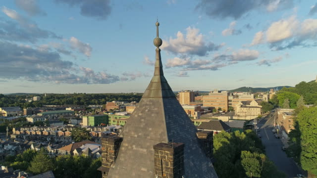panoramic scenic view of bethlehem, pennsylvania, at sunset. fritz memorial united methodist church. aerial drone video with the ascending camera motion. - bethlehem pennsylvania stock videos and b-roll footage
