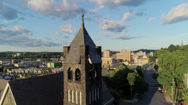 panoramic scenic view of bethlehem, pennsylvania, at sunset. fritz memorial united methodist church. aerial drone video with the orbit and ascending cinematic camera motion. - bethlehem pennsylvania stock videos & royalty-free footage