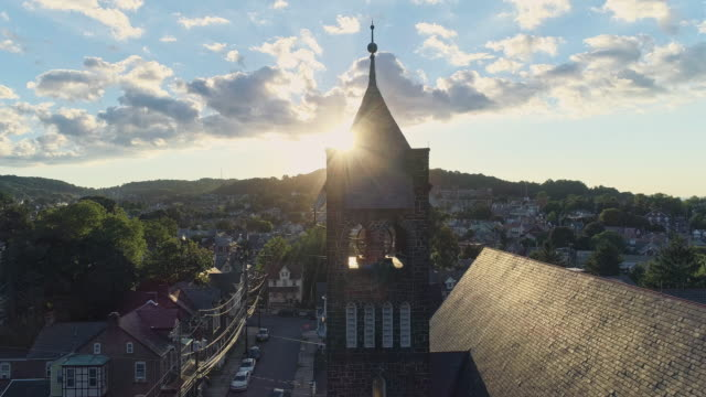panoramic scenic view of bethlehem, pennsylvania, at sunset. fritz memorial united methodist church. aerial drone video with panoramic camera motion. - spire stock videos & royalty-free footage